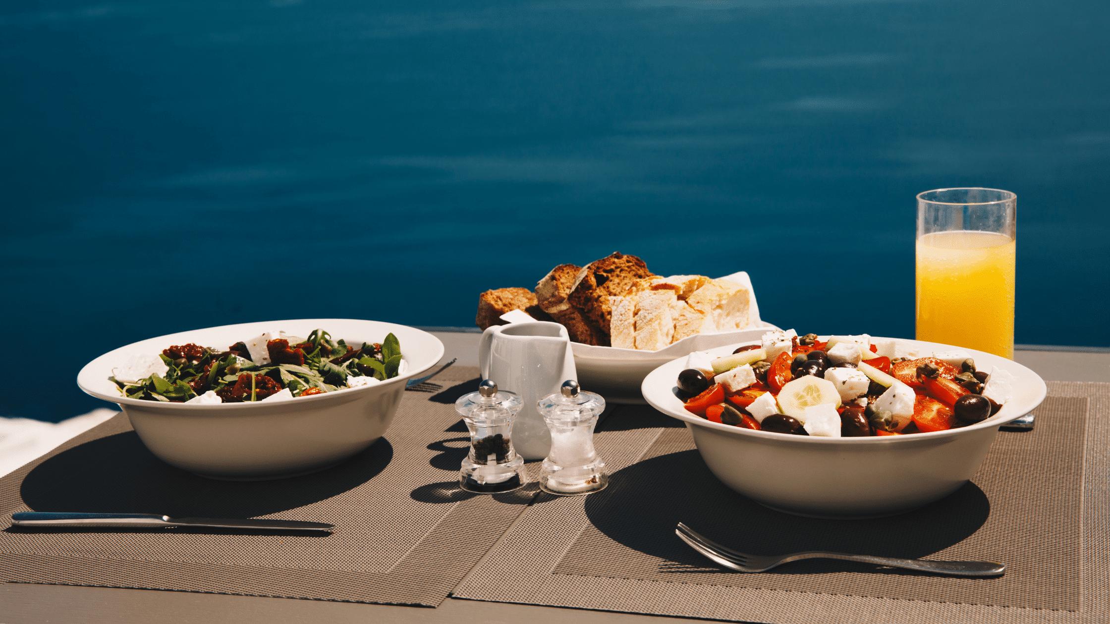 Food on table next to pool