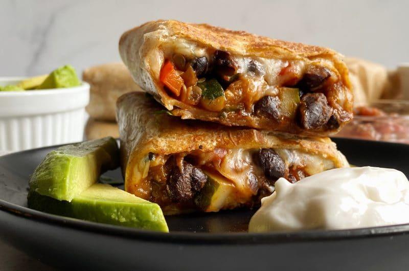 veggie and black bean burrito on a plate